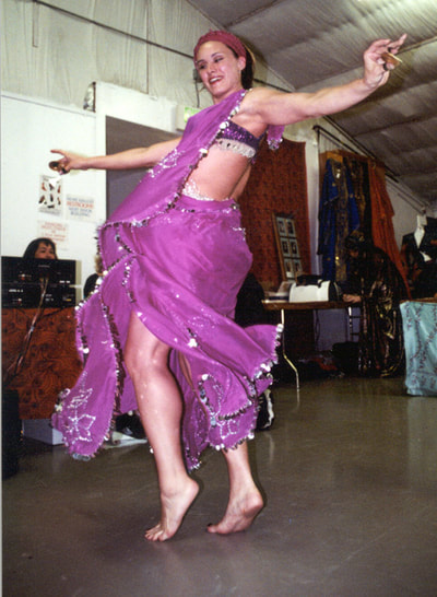 Suzanna as a baby belly dancer (one of her first 10 performances!)