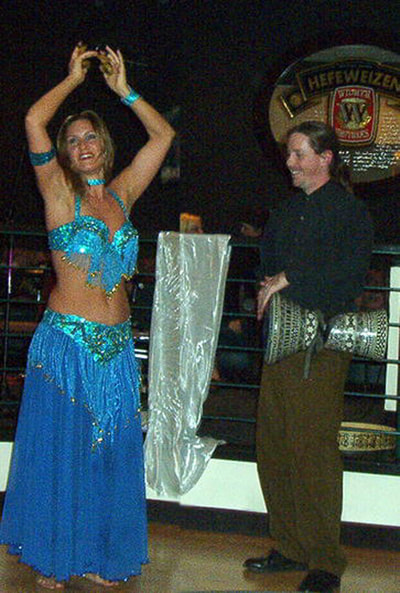 Suzanna as a baby belly dancer with Erik Brown.